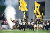 Appalachian State Mountaineers cheerleaders run on to the field prior to their game against the Ohio Bobcats on December 19 2015 at the Cramton Bowl...