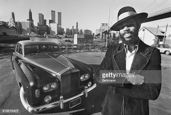 Apparently determined to match his flashy drives on the basketball court with some equally flashy driving New York Knicks' star guard Walt Frazier...