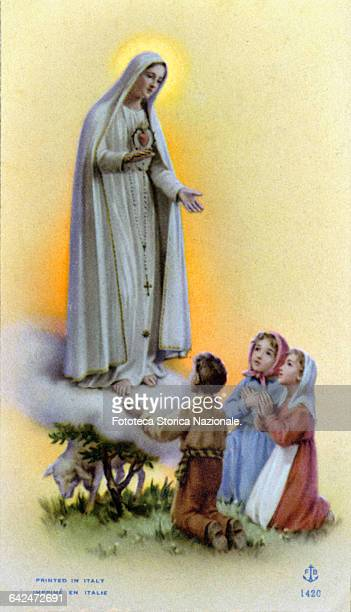Apparition of Our Lady of Fatima which took place May 13 1917 in front of three little shepherds the brothers Francisco Marto and Jacinta Marto and...