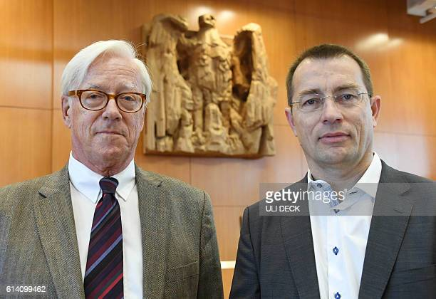 Appellants Roman Huber of the association 'More Democracy' and Thilo Bode chairman of Foodwatch wait for the opening of a hearing of an emergency...