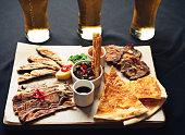 fried appetizer beer sidedish on cutting board