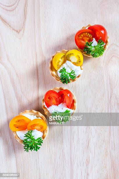 Appetizer of cherry tomatoes and creme cheese