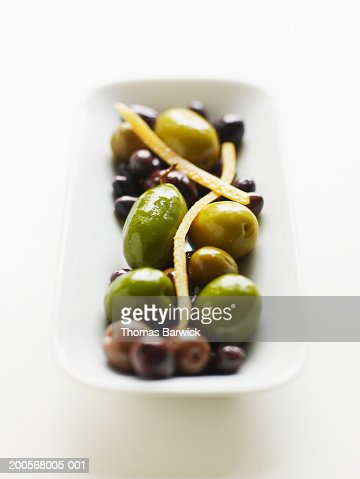 Appetizer of warm marinated olives, close-up : Stock Photo