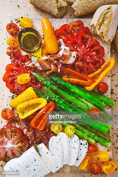 Appetizer plate - grilled vegetables with prosciutto and Mozzarella cheese