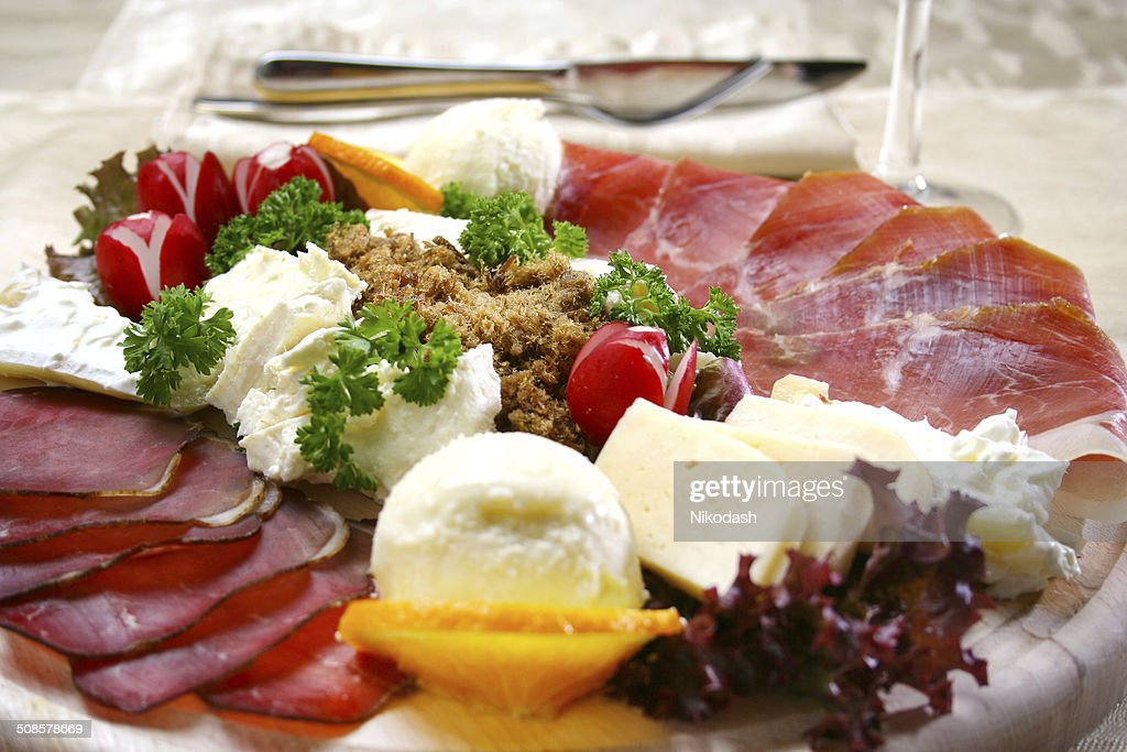 appetizer with ham on wooden board and cheese : Stock Photo