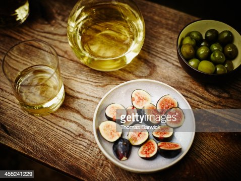 Appetizers and wine on outdoor table : Stock Photo