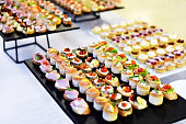 Catering food shot with small appetizers on plates ready for eat