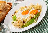 Appetizing cauliflower fried eggs for breakfast
