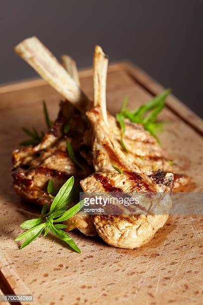 Appetizing grilled cutlets on a wooden cutting board.