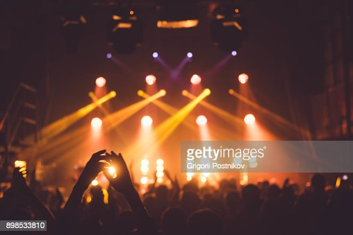 applause and raised hands at concert. Nightclub life : Stock Photo