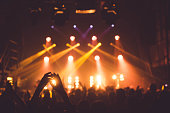applause and raised hands at concert. Nightclub life