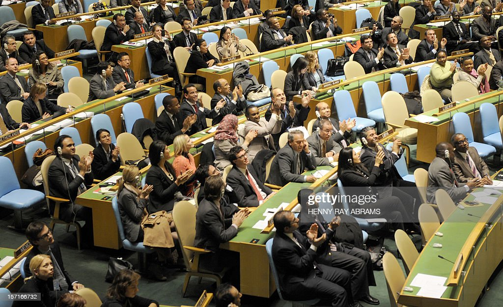 Applause breaks out among many delegations after the United Nations General Assembly passed a resolution to upgrade the status of the Palestinian Authority to a nonmember observer state November 29, 2012 at UN headquarters in New York. AFP PHOTO/Henny Ray Abrams