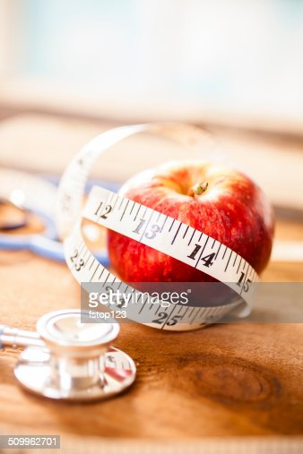 Apple a day keeps the doctor away.  Stethoscope, tape measure.