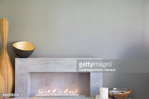 Apple art above fireplace in modern living room