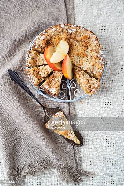 Apple cake with crumble and cinnamon, piece of cake on cake server