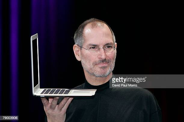 Apple CEO and cofounder Steve Jobs holds up the new Mac Book Air after he delivered the keynote speech to kick off the 2008 Macworld at the Moscone...