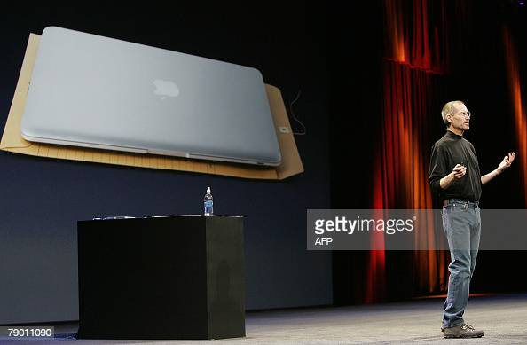 Apple CEO and cofounder Steve Jobs shows off the new Macbook Air ultra portable laptop during his keynote speech at the MacWorld Conference Expo in...