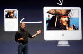 Apple CEO Steve Jobs announces new video downloads from iTunes as he delivers a keynote address during an Apple media event September 12 2006 in San...