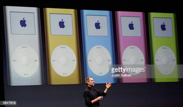 Apple CEO Steve Jobs announces the new mini iPod available in five colors during a keynote address at Macworld January 6 2004 in San Francisco Jobs...