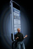 Apple CEO Steve Jobs delivers the keynote address in front of a projected image of the soon to be released iPhone at the Apple Worldwide Web...