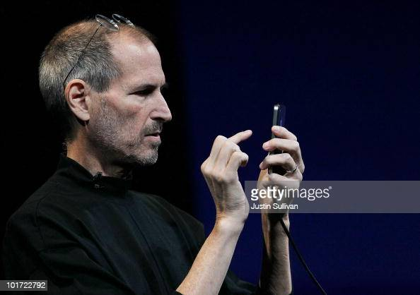 Apple CEO Steve Jobs demonstrates the new iPhone 4 as he delivers the opening keynote address at the 2010 Apple World Wide Developers conference June...