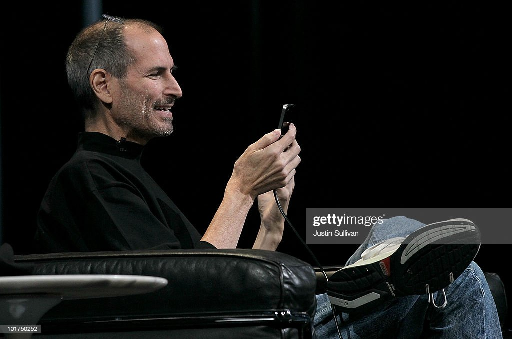 Apple CEO Steve Jobs demonstrates the new iPhone 4 as he delivers the opening keynote address at the 2010 Apple World Wide Developers conference June 7, 2010 in San Francisco, California. Jobs kicked off the annual WWDC with the official unveiling of the latest version of the iPhone.