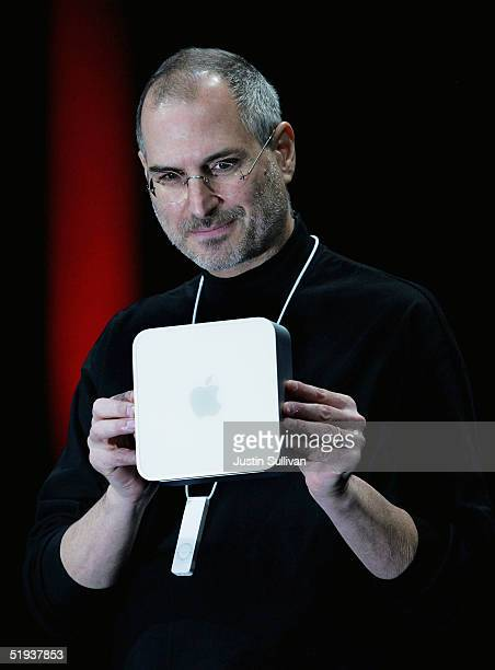 Apple CEO Steve Jobs displays the new Mac Mini personal computer at the 2005 Macworld Expo January 11 2005 in San Francisco California Jobs announced...
