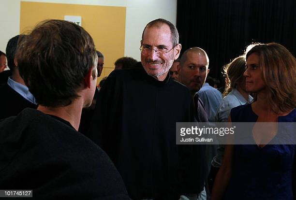 Apple CEO Steve Jobs greets an attendee after he delivered the opening keynote address at the 2010 Apple World Wide Developers conference June 7 2010...