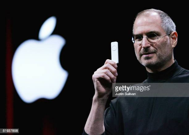 Apple CEO Steve Jobs holds a new iPod shuffle MP3 player at the 2005 Macworld Expo January 11 2005 in San Francisco California Jobs announced several...