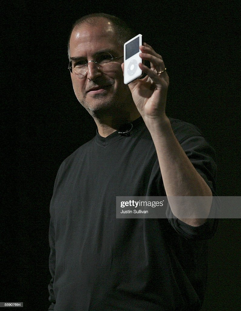 Apple CEO <a gi-track='captionPersonalityLinkClicked' href=/galleries/search?phrase=Steve+Jobs&family=editorial&specificpeople=204493 ng-click='$event.stopPropagation()'>Steve Jobs</a> holds a new iPod with video capabilities as he delivers a keynote address October 12, 2005 in San Jose, California. Apple CEO <a gi-track='captionPersonalityLinkClicked' href=/galleries/search?phrase=Steve+Jobs&family=editorial&specificpeople=204493 ng-click='$event.stopPropagation()'>Steve Jobs</a> announced a new iPod that plays video, a new iMac and new version of iTunes that allows people to purchase videos and television shows.