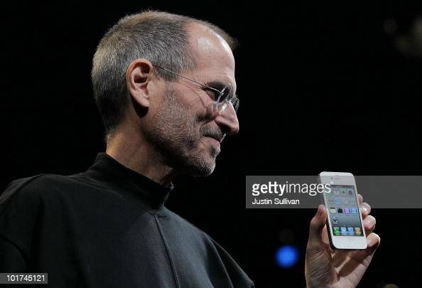 Apple CEO Steve Jobs holds the new iPhone 4 after he delivered the opening keynote address at the 2010 Apple World Wide Developers conference June 7...