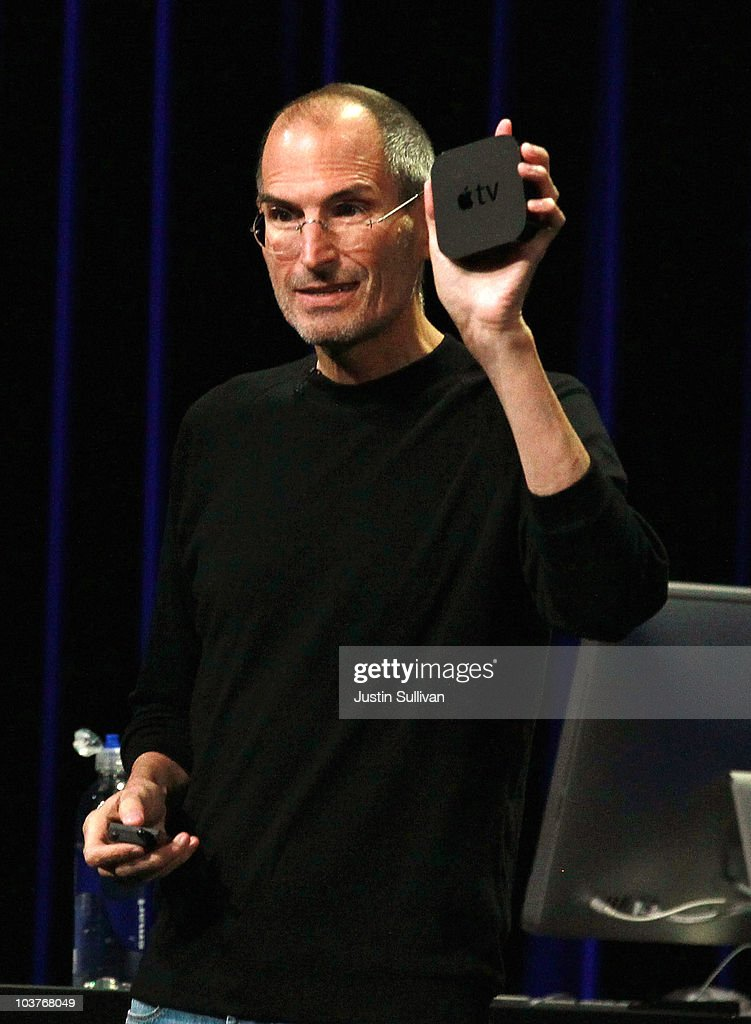 Apple CEO Steve Jobs holds the new, smaller Apple TV device as speaks during an Apple Special Event at the Yerba Buena Center for the Arts September 1, 2010 in San Francisco, California. Jobs announced upgraded versions of the entire iPod line, including an iPod Touch that includes a camera. He also showed the new iTunes version 10 and the release of the second generation of Apple TV.