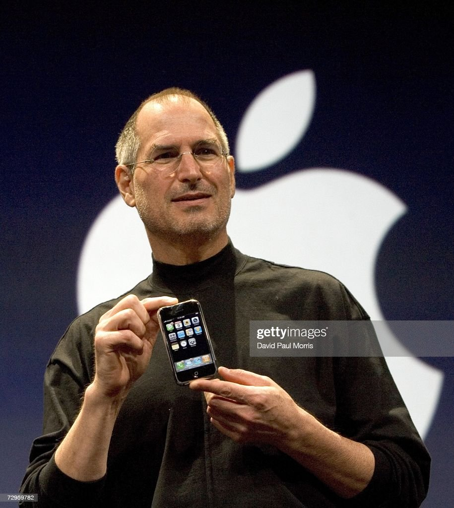 Apple CEO Steve Jobs holds up the new iPhone that was introduced at Macworld on January 9, 2007 in San Francisco, California. During the keynote Jobs introduced the new iPhone which will combine a mobile phone, a widescreen iPod with touch controls and a internet communications device with the ability to use email, web browsing, maps and searching. The iPhone will start shipping in the US in June 2007.