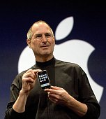 Apple CEO Steve Jobs holds up the new iPhone that was introduced at Macworld on January 9 2007 in San Francisco California During the keynote Jobs...