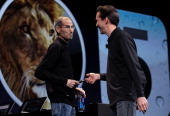 Apple CEO Steve Jobs jokes with Scott Forstall Senior VP of iPhone Software as he delivers the keynote address at the 2011 Apple World Wide...