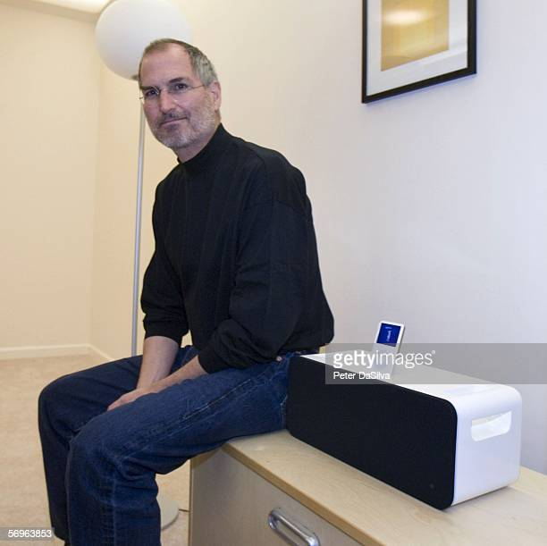 Apple CEO Steve Jobs poses next to the new iPod HiFi speaker system designed for the iPod during a special Apple event February 28 2006 in Cupertino...