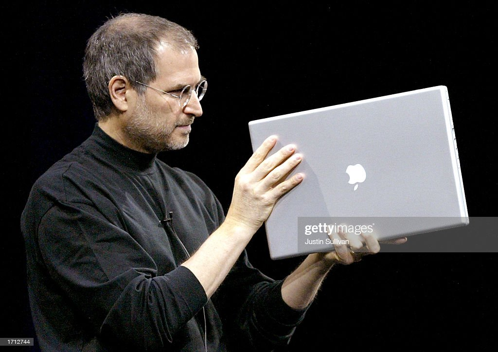 Apple CEO Steve Jobs shows off the new 17-inch Powerbook G4 while delivering the keynote address at Macworld January 7, 2003 in San Francisco. Along with the new 17-inch powerbook, Jobs also announced a 12-inch version as well as several new software updates.
