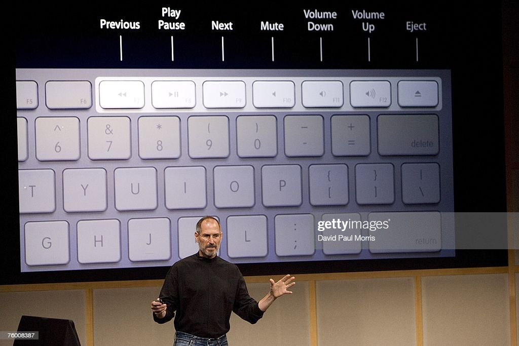 Apple CEO Steve Jobs shows off the new wireless keyboard as he introduces new versions of the iMac and iLife applications August 7, 2007 in Cupertino, California. The all-in-one desktop computers now have a slimmer design in aluminum casings with faster chips and glossy screens and is up to $300 cheaper then their predecessors.