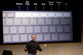 Apple CEO Steve Jobs shows off the new wireless keyboard as he introduces new versions of the iMac and iLife applications August 7 2007 in Cupertino...