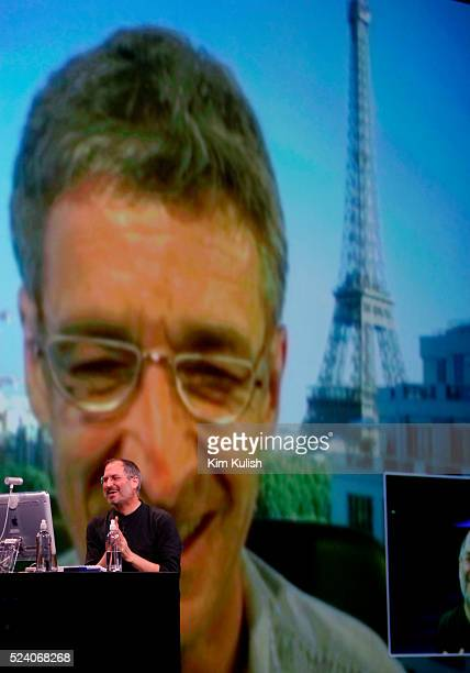 STATES Apple CEO Steve Jobs sits at his computer during a live video conference with JeanMarie Hullot at his home in Paris France during his keynote...