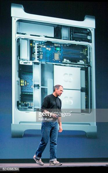 STATES Apple CEO Steve Jobs stand in front of a picture of the inside of the Apple Power Mac G5 personal computer while introducing it to the world...