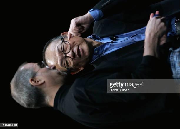Apple CEO Steve Jobs talks with Sony President Kunitake Ando at the 2005 Macworld Expo January 11 2005 in San Francisco California Jobs announced...