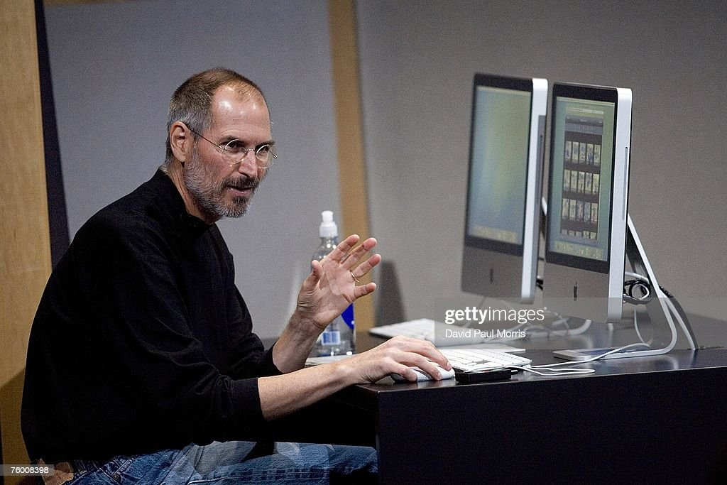 Apple CEO Steve Jobs uses a new iMac computer as he demonstrates new versions of the iMac and iLife applications August 7, 2007 in Cupertino, California. The all-in-one desktop computers now have a slimmer design in aluminum casings with faster chips and glossy screens and is up to $300 cheaper then their predecessors.