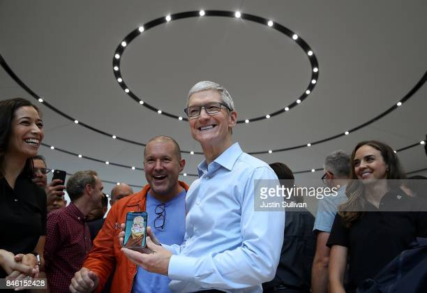 Apple CEO Tim Cook and Apple chief design officer Jonathan Ive look at the new Apple iPhone X during an Apple special event at the Steve Jobs Theatre...