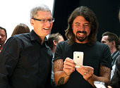 Apple CEO Tim Cook and Dave Grohl of the Foo Fighters look at the new iPhone 5 during an Apple special event at the Yerba Buena Center for the Arts...