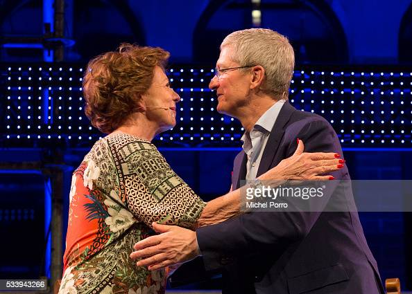 Apple CEO Tim Cook and Neelie Kroes greet each other during the kickoff of Startup Fest Europe on May 24 2016 in Amsterdam The Netherlands The event...