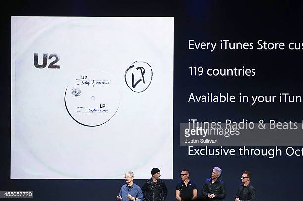 Apple CEO Tim Cook announces the free download of the new U2 album on iTunes as members of U2 The Edge Larry Mullen Jr Adam Clayton and Bono as and...