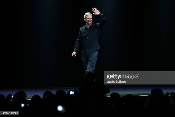 Apple CEO Tim Cook arrives to speak during the Apple Worldwide Developers Conference at the Moscone West center on June 2 2014 in San Francisco...
