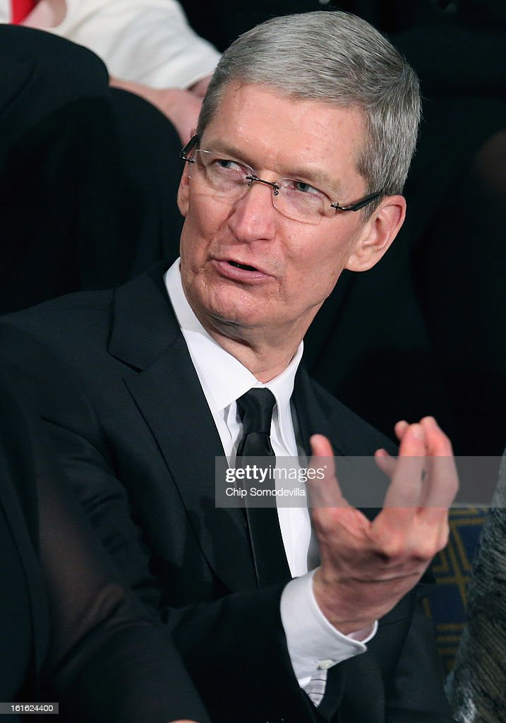 Apple CEO Tim Cook attends U.S. President Barack Obama's State of the Union speech before a joint session of Congress at the U.S. Capitol February 12, 2013 in Washington, DC. Facing a divided Congress, Obama focused his speech on new initiatives designed to stimulate the U.S. economy and said, 'ItÕs not a bigger government we need, but a smarter government that sets priorities and invests in broad-based growth'.