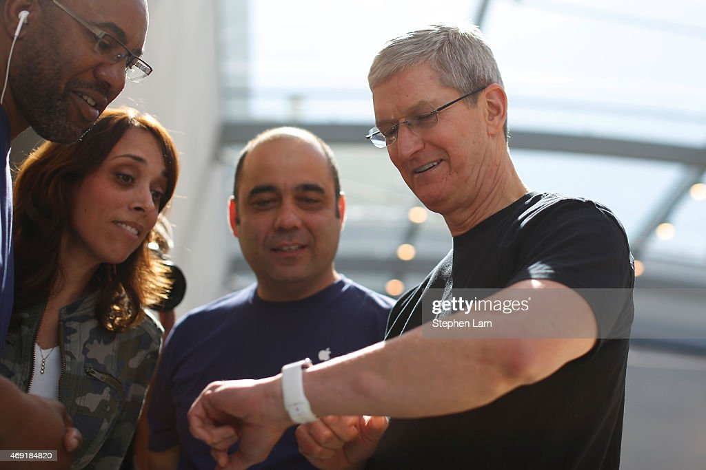 Apple CEO Tim Cook displays his personal Apple Watch to customers at an Apple Store on April 10, 2015 in Palo Alto, California. The pre-orders of the highly-anticipated wearable from the tech giant begins today as the watches arrive at stores for customers to preview.